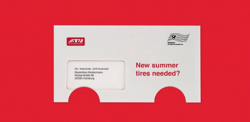 """The direct mail piece from German auto repair chain, ATU. An envelope with circles cut out. """"New summer tires needed?"""""""