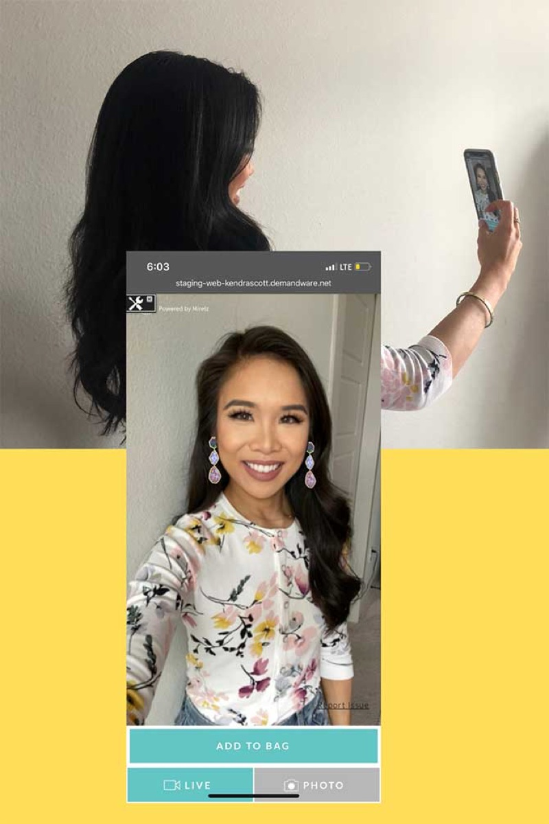 A female blogger tries on a pair of earrings virtually.
