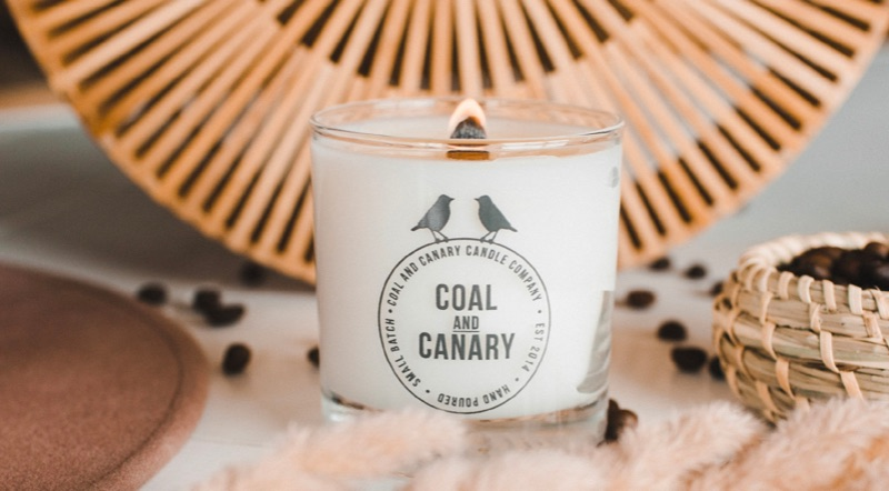 A lit Coal and Canary candle.