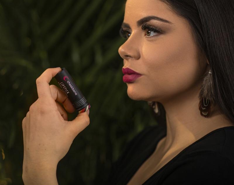 Jenn Harper, Founder and CEO of Cheekbone Beauty Cosmetics, holds a Cheekbone Beauty lipstick.