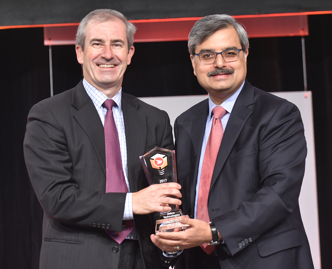 Joe Heel, Senior Vice-President, Global Sales for Zebra Technologies, accepted the Canada Post E-commerce Innovator's Award from Deepak Chopra, President and CEO of Canada Post.