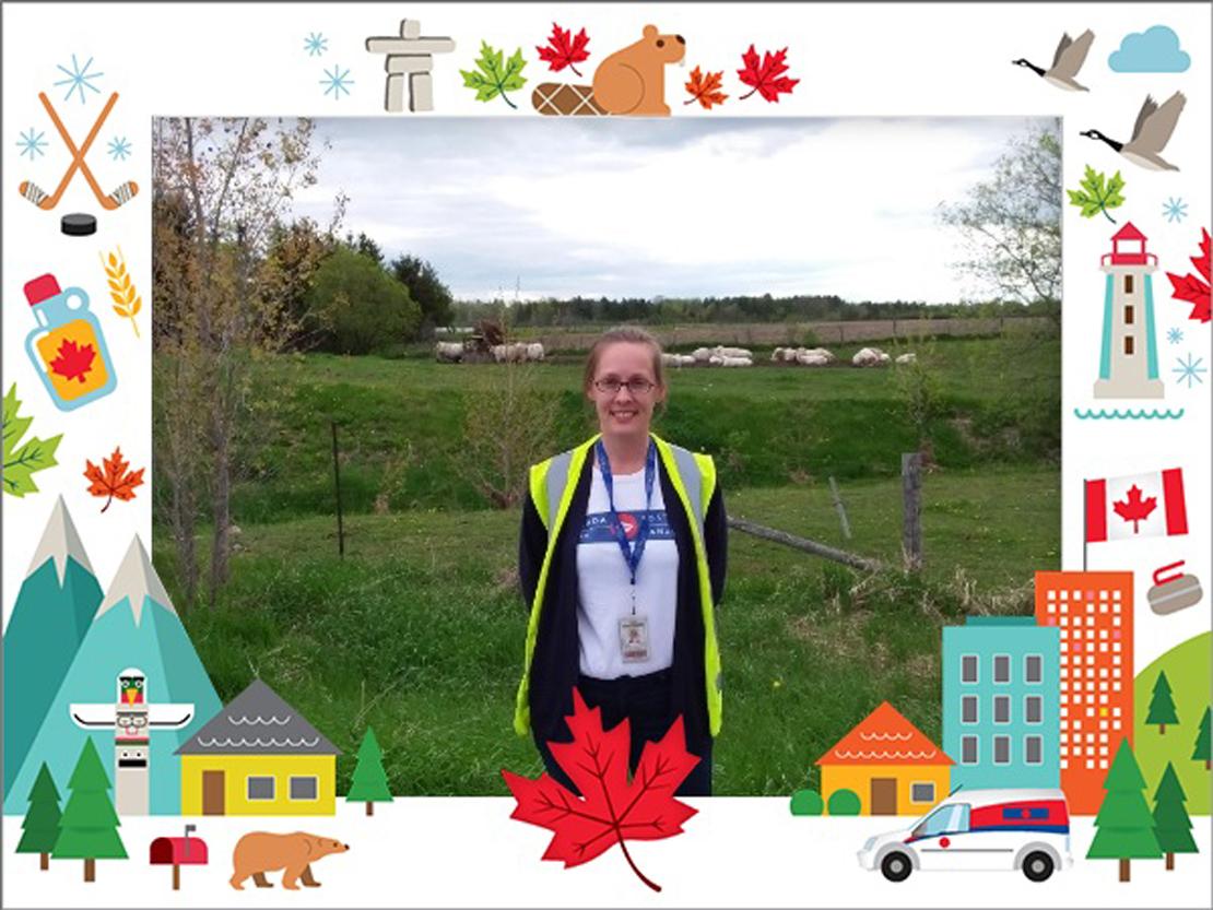 Canada Post employee posing in rural community.