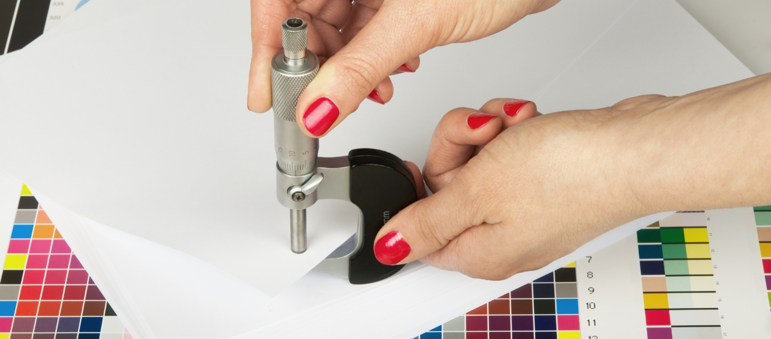 A printer works on the design of a custom mailer.