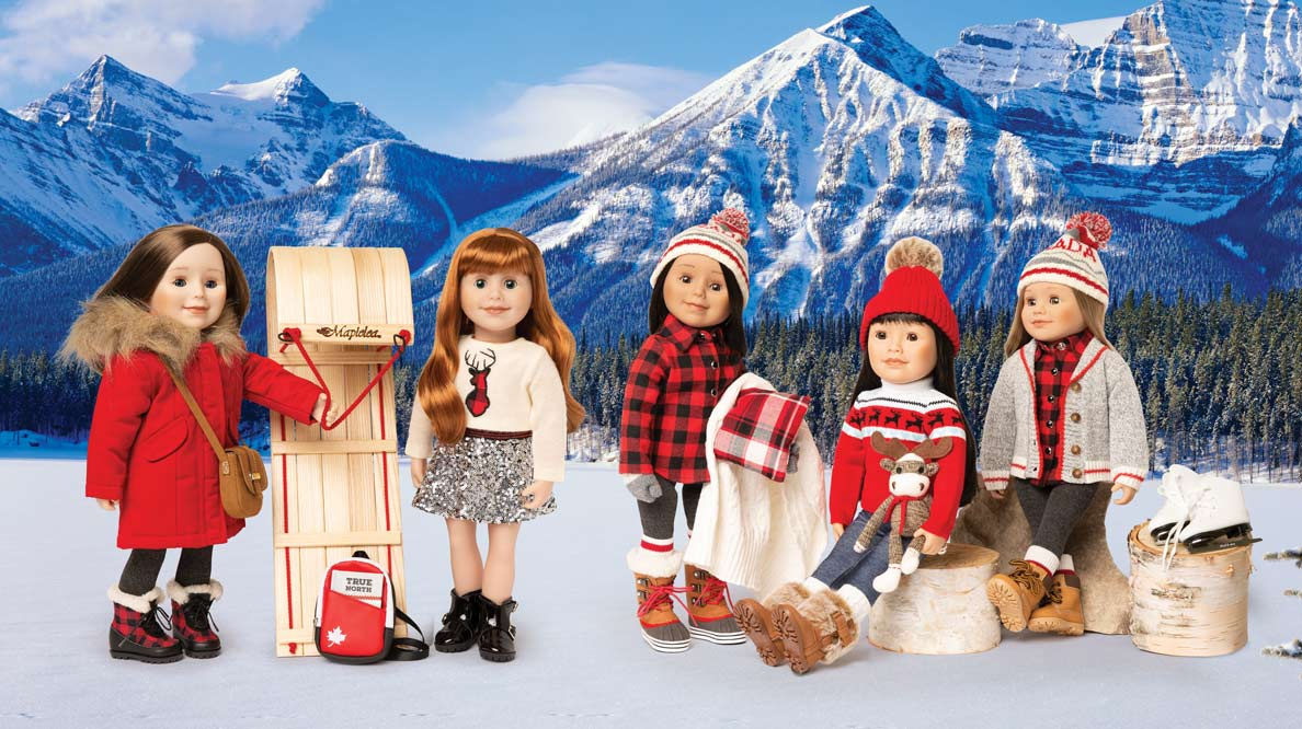 Maplelea Girl Canadiana-themed dolls posed against a backdrop of the Rockies.