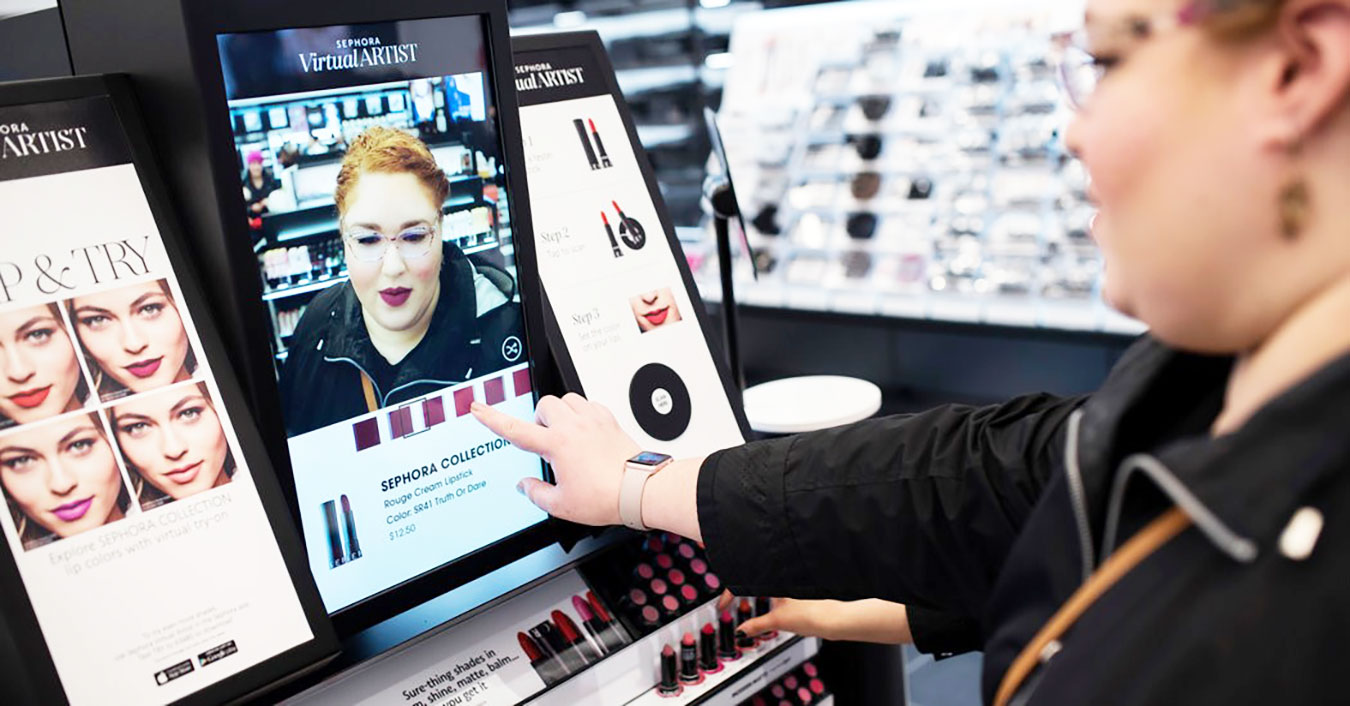 A young woman explores the Sephora Visual Artist app on a tablet in a Sephora store. Source: Perch Interactive.