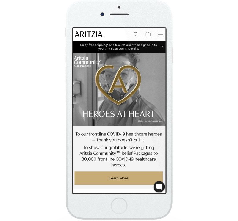 Aritzia's website promotes free shipping and free returns. They also promote their community outreach initiative – the Aritzia Relief Packages program for frontline workers.