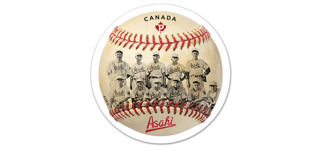 Baseball with red stitching printed with photo of 11 members of Vancouver Asahi team