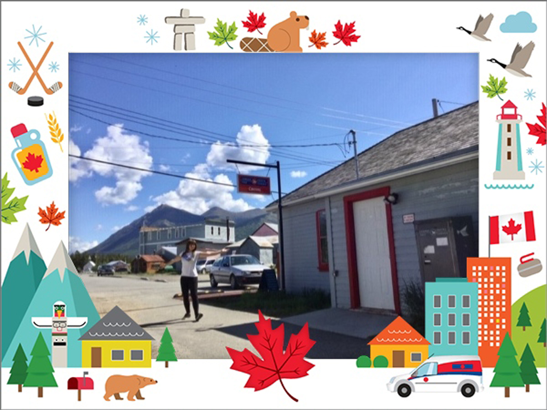 Photo of a Canada Post employee in fron of the post office in Carcross, Yukon.