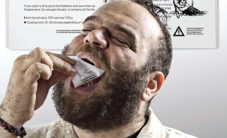 Close up of bearded man eating Landrover manual page.