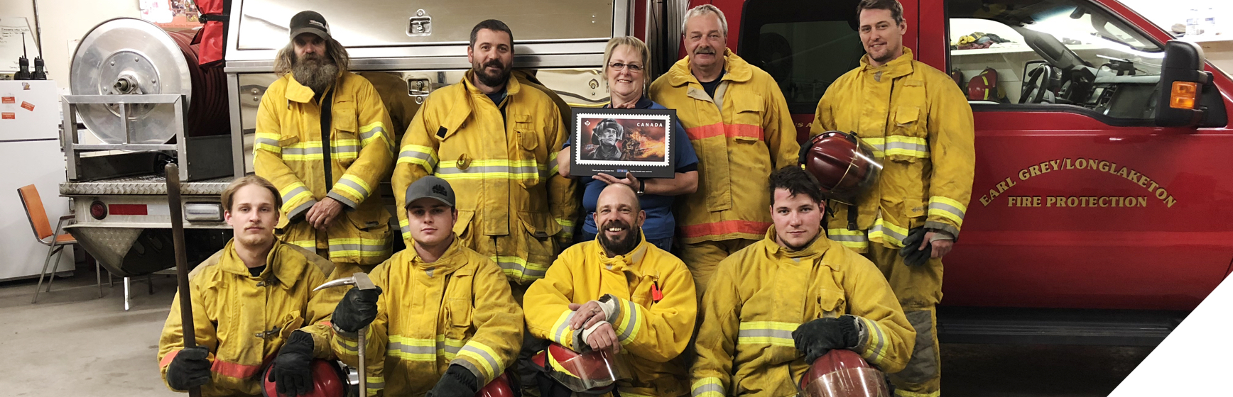 Firefighters in Earl Grey, Sask. receive commemorative plaque of the Emergency Responders stamp honouring firefighters.