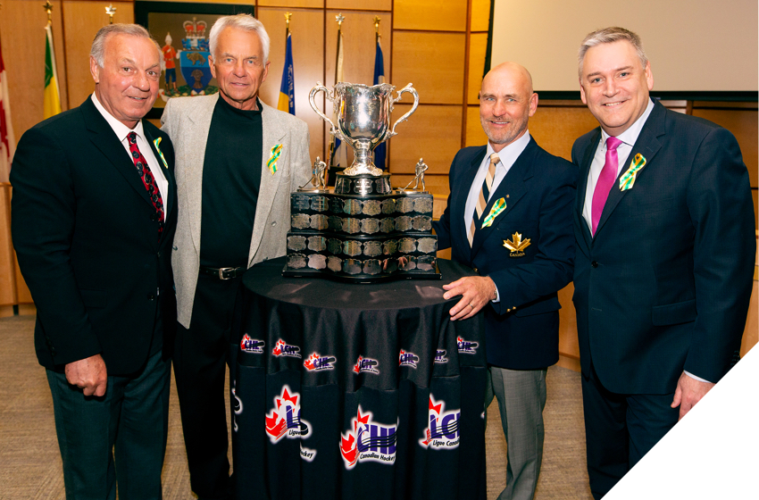 Former NHL players Guy Lafleur, Dennis Sobchuk and Ed Staniowski with Memorial Cup and Doug Ettinger, CEO, Canada Post.
