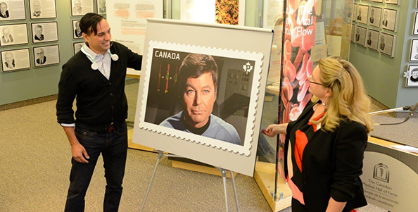 Sonny Kohli and Lissa Foster unveil the Dr. Leonard McCoy stamp